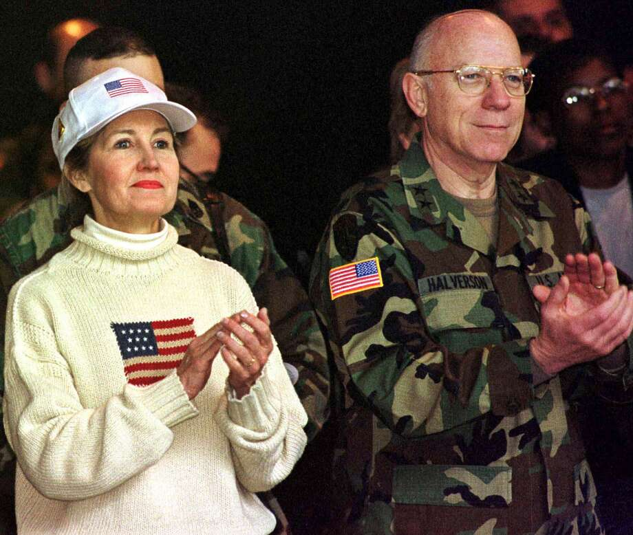 Sen. Kay Bailey Hutchison and Major Gen. Robert L. Halverson of Austin, Texas, commander of U.S. troops in northern Bosnia clap during an Easter Sunrise Service at U.S. Base Eagle, near Tuzla, Bosnia, Sunday, April 23, 2000. Photo: Amel Emric, The Associated Press / AP