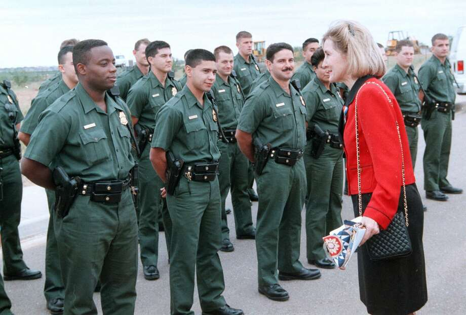 Sen. Kay Bailey Hutchison greets U.S. Border Patrol agents-in-training Wednesday, Nov. 11, 1998, prior to a groundbreaking ceremony for a new Border Patrol headquarters in Laredo, Texas. Photo: J. Michael Short, The Associated Press / LAREDO MORNING TIMES