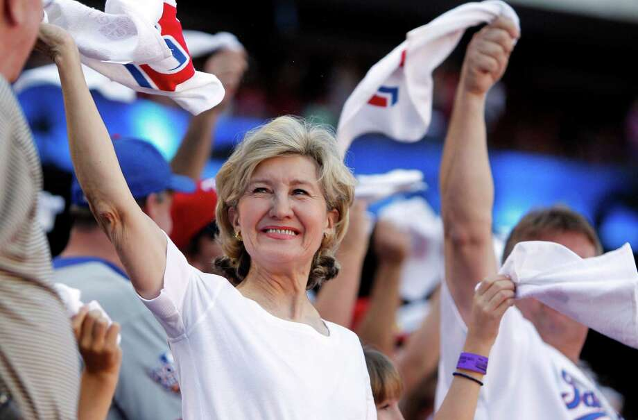 U.S. Sen. Kay Bailey Hutchison swings a towel in support of the Texas Rangers before Game 2 of baseball's American League division series playoffs against the Tampa Bay Rays, Saturday, Oct. 1, 2011, in Arlington, Texas. Photo: LM Otero, The Associated Press / AP