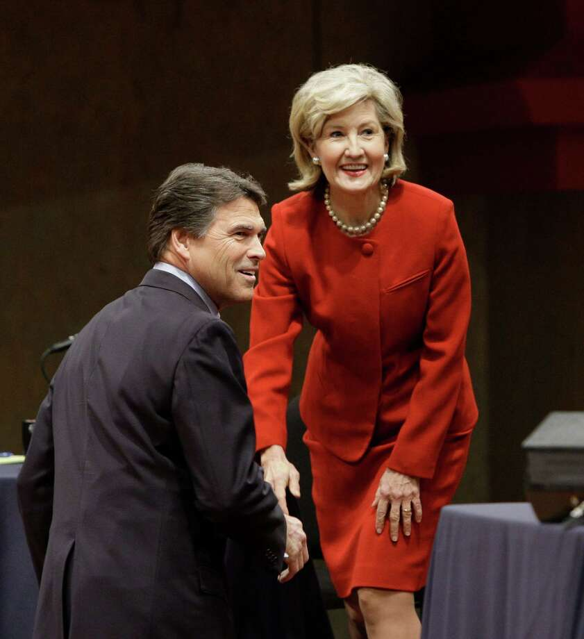 Texas Gov. Rick Perry and U.S. Sen. Kay Bailey Hutchison smile after greeting each other at the Murchison Performing Arts Center at the University of North Texas in Denton, Texas, Thursday, Jan. 14, 2010. Photo: LM Otero, The Associated Press / AP Pool