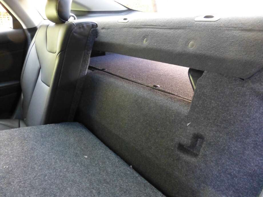 It\'s a pretty thin pass-through from the trunk to the rear seat area.