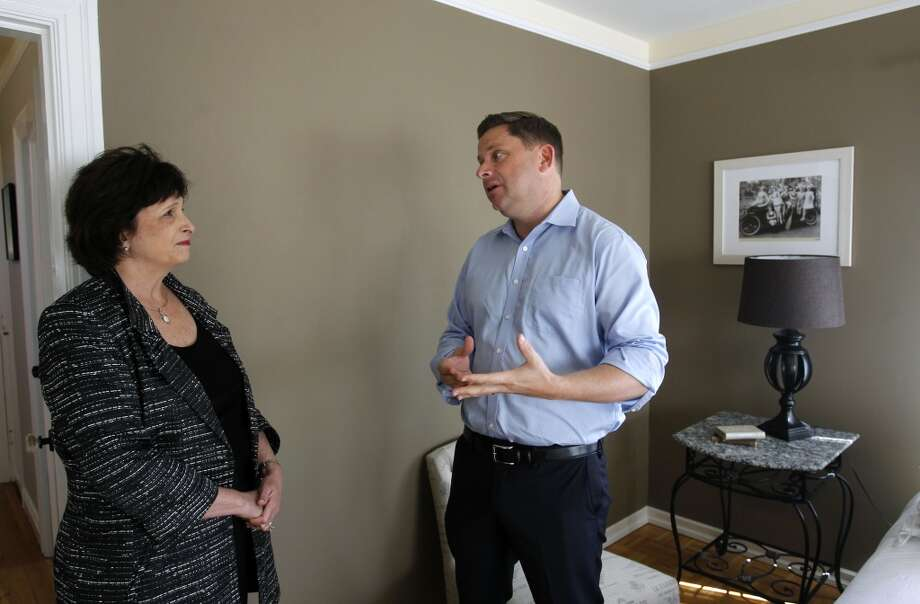 Real estate agent Carrie Du Bois chats with Bob Bredel while viewing an open home for sale in San Carlos, Calif. on Tuesday, April 9, 2013. Du Bois, also a school board member for the Sequoia Union High School District, says there's a lot of competition for homes where schools have the highest test scores.