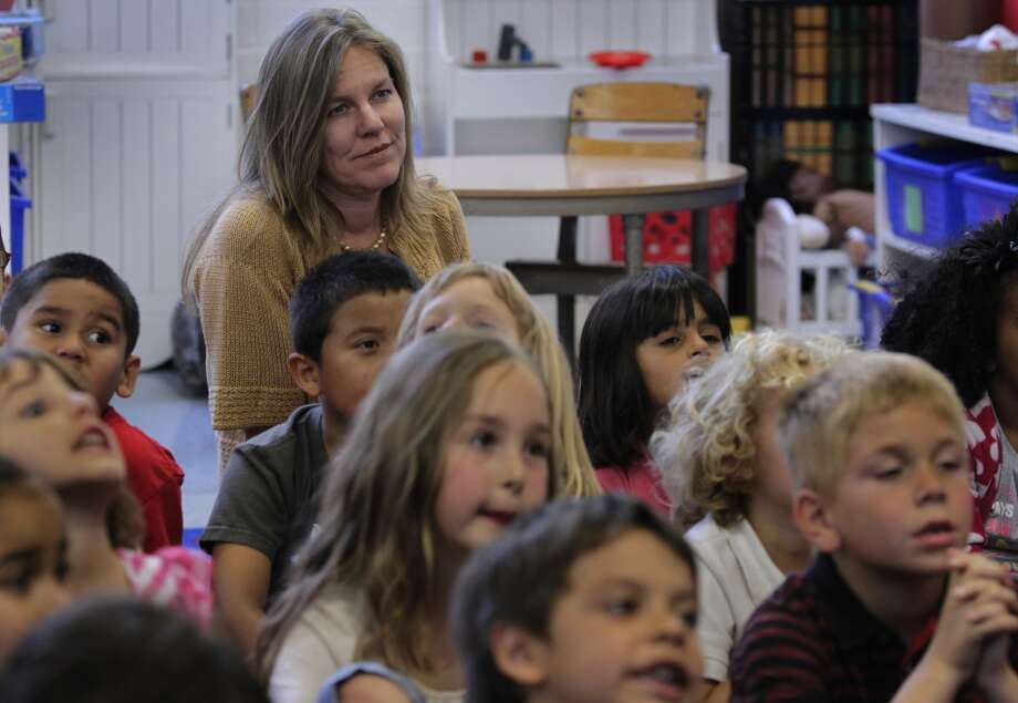 School Board president Shelly Masur observes a kindergarten class at Clifford Elementary School in Redwood City, Calif. on Friday, April 12, 2013. Some homes in San Carlos that are within Clifford\'s region sell at a slightly lower value because the school\'s test scores are not quite as high as others in the area.
