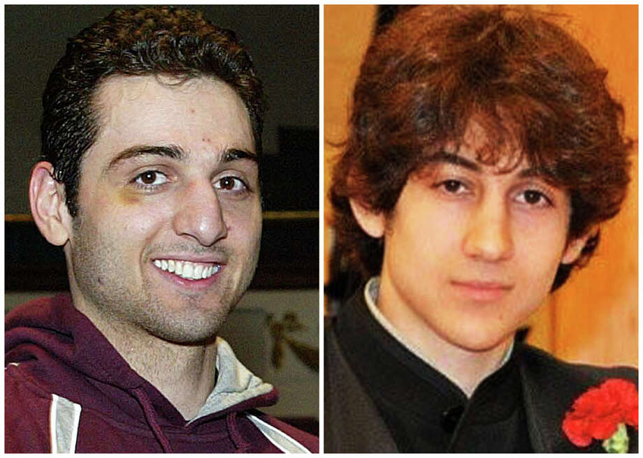 This combination of undated photos shows Tamerlan Tsarnaev, 26, left, and Dzhokhar Tsarnaev, 19. The FBI says the two brothers and suspects in the Boston Marathon bombing killed an MIT police officer, injured a transit officer in a firefight and threw explosive devices at police during a getaway attempt in a long night of violence that left Tamerlan dead and Dzhokhar still at large on Friday, April 19, 2013. The ethnic Chechen brothers lived in Dagestan, which borders the Chechnya region in southern Russia. They lived near Boston and had been in the U.S. for about a decade, one of their uncles reported said. Photo: Associated Press / AP