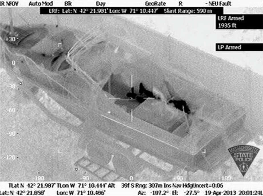 This Friday, April 19, 2013 image made available by the Massachusetts State Police shows 19-year-old Boston Marathon bombing suspect, Dzhokhar Tsarnaev, hiding inside a boat during a search for him in Watertown, Mass. He was pulled, wounded and bloody, from the boat parked in the backyard of a home in the Greater Boston area. Photo: HOPD / Massachusetts State Police