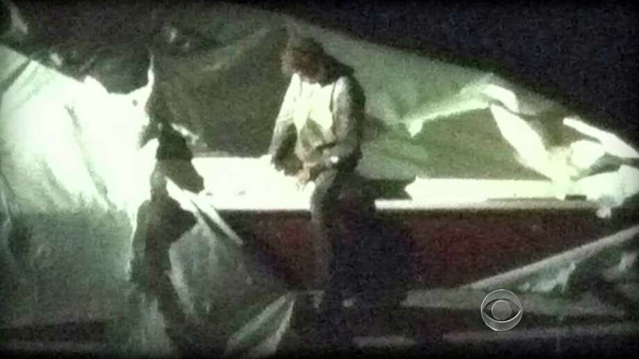 This image obtained April 19, 2013 courtesy CBS News shows Dzhokhar Tsarnaev, a suspect in the Boston Marathon bombing who was captured Friday night, April 19, 2013  after he was found hiding in a boat in a Boston suburb.  US police captured an ethnic Chechen teenager suspected of staging the Boston marathon bombings, after a massive manhunt that virtually shut down the city and its suburbs.  After a tip from a local resident, police found Dzhokhar Tsarnaev, 19, hiding in a boat in a suburban backyard in Watertown, wounded and weary after a gun battle with police overnight in which his accomplice brother was killed. Photo: CBS NEWS, AFP/Getty Images / AFP