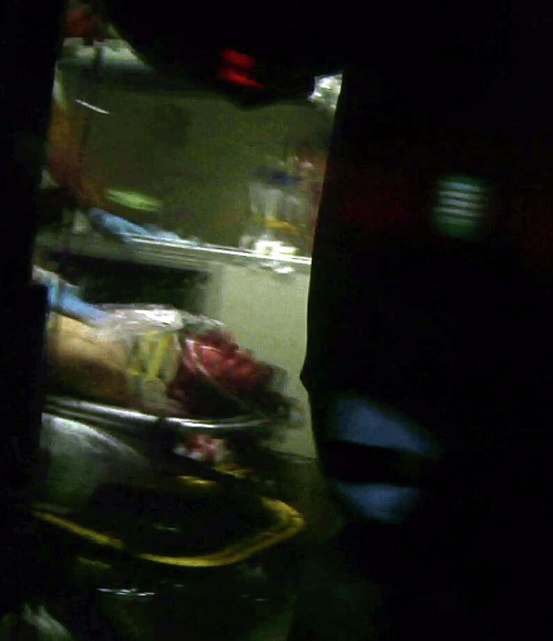 This still frame from video shows Boston Marathon bombing suspect Dzhokhar Tsarnaev visible through an ambulance after he was captured in Watertown, Mass., Friday, April 19, 2013. The 19-year-old college student wanted in the Boston Marathon bombings was taken into custody Friday evening after a manhunt that left the city virtually paralyzed and his older brother and accomplice dead. Photo: Robert Ray