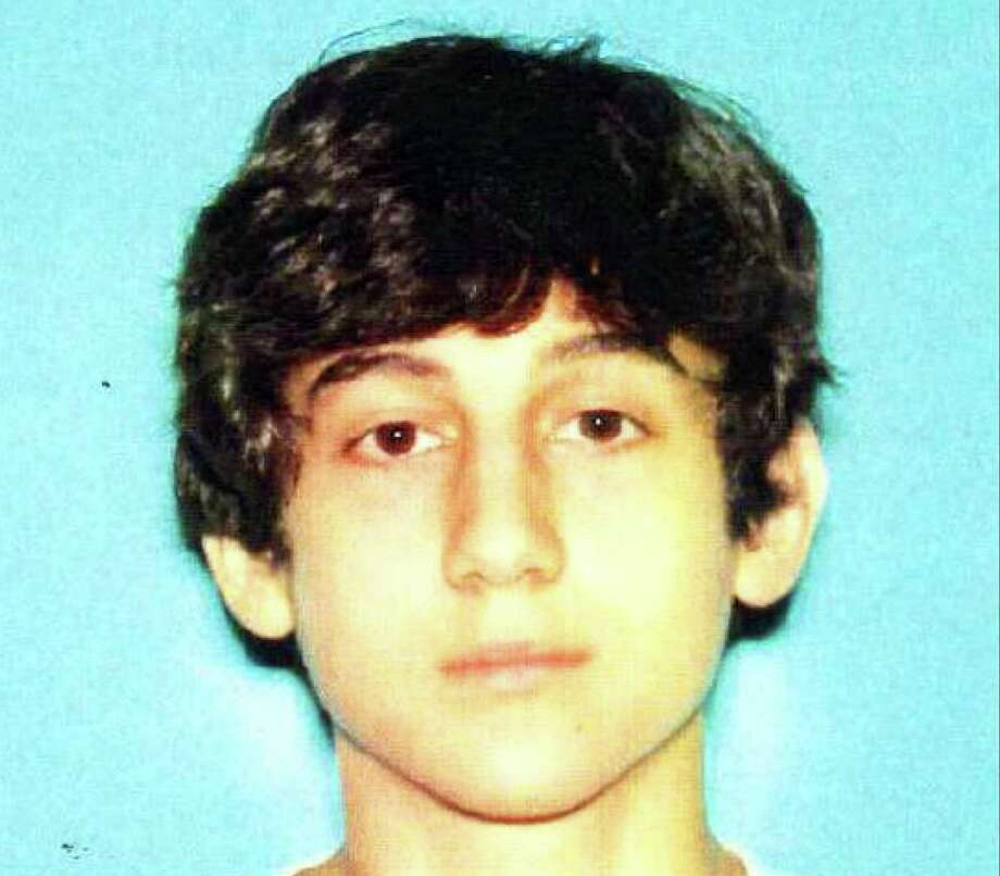 This image provided by the Boston Regional Intelligence Center shows Dzhokhar A. Tsarnaev, identified by the FBI as suspect number 2, in the Boston Marathon bombings. Authorities say Tsarnaev is still at large after he and another suspect — both identified to The Associated Press as coming from the Russian region near Chechnya — killed an MIT police officer, injured a transit officer in a firefight and threw explosive devices at police during their getaway attempt in a long night of violence into the early hours of Friday, April 19, 2013. The second suspect, who has not yet been identified, was killed in a shootout with police. Photo: Boston Regional Intelligence Center