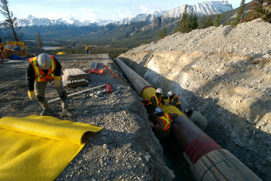 Workers lay pipe in Jasper National Park, as part of the Anchor Loop project. Photo: Trans Mountain