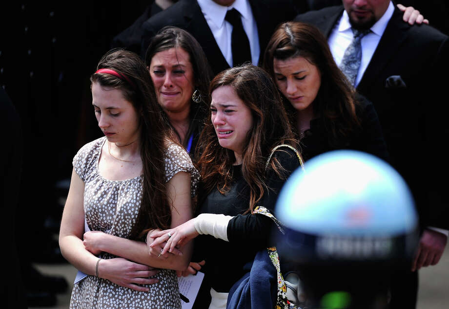 Mourners walk out of  St. Joseph Catholic Church after the funeral service for Krystle Campbell, a victim of the Boston Marathon bombing, on April 22, 2013 in Medford, Massachusetts. A manhunt ended for Dzhokhar A. Tsarnaev, 19, a suspect in the Boston Marathon bombing after he was apprehended on a boat parked on a residential property in Watertown, Massachusetts. His brother Tamerlan Tsarnaev, 26, the other suspect, was shot and killed after a car chase and shootout with police. The bombing, on April 15 at the finish line of the marathon, killed three people and wounded at least 170. Photo: Kevork Djansezian, Getty Images / 2013 Getty Images