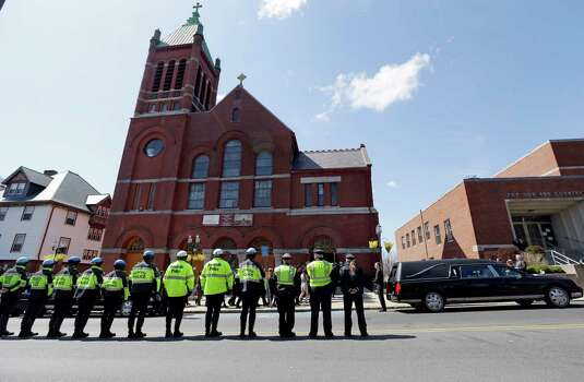Medford and Somerville police line the street outside St. Joseph's Church in Medford, Mass. Monday, April 22, 2013 for the funeral of Boston Marathon bomb victim Krystle Campbell, 29. Photo: Elise Amendola