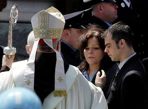 Boston Cardinal Sean O'Malley comforts Patty Campbell and her son, Billy, after a  funeral for her daugher, Krystle Campbell, 29, at St. Joseph's Church in Medford, Mass. Monday, April 22, 2013. Krystle Campbell is one of three victims killed in the Boston Marathon explosions. Photo: Elise Amendola