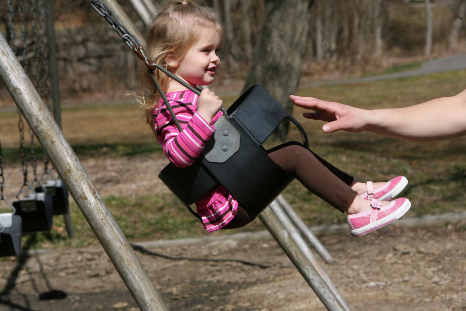 Khloe Shipchack, 2, of Shelton gets a push from her dad, Justin, at Pine Rock Park in Shelton, Conn. on Monday, March 12, 2012. Photo: B.K. Angeletti / Connecticut Post