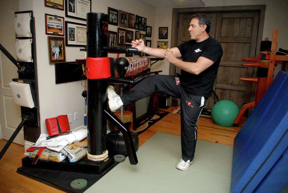 Steven Biggica at home in Stamford, Conn. on Monday April 22, 2013. Biggia practices martial arts and collects Asian art, he recently opened a martial arts studio in Stamford. Photo: Dru Nadler / Stamford Advocate Freelance