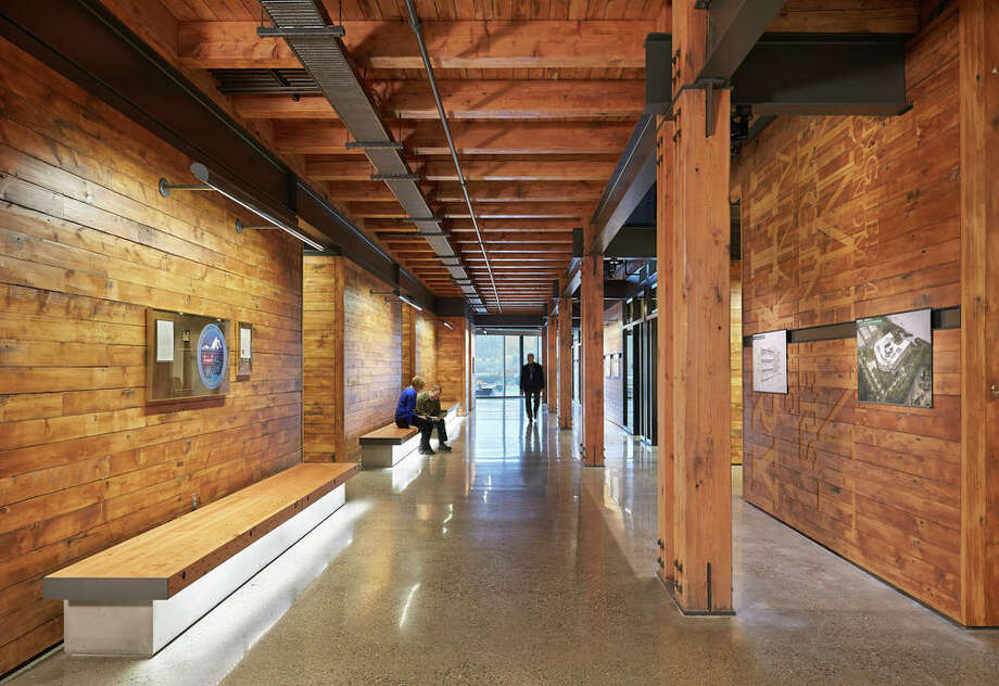 "The reclaimed timber ""creates a warm and sustainable environment that reflects and repurposes the historic context of the site,"" according to a project writeup. Photo: Benjamin Benschneider;copyright Benjamin Benschneider , Benjamin Benschneider"