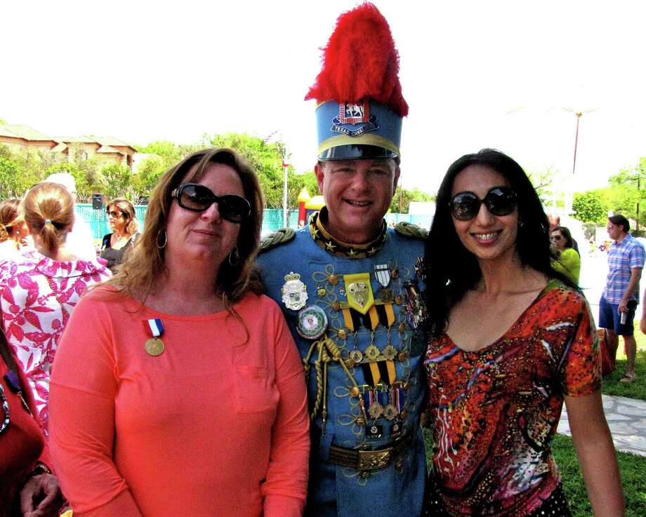 King Antonio Steve Dutton greets Gena Comella (left) and Zhanna Funaro at the Texas Cavaliers' King's Party on Sunday at the Alamo Heights city pool. Photo: Edmond Ortiz / North Central New