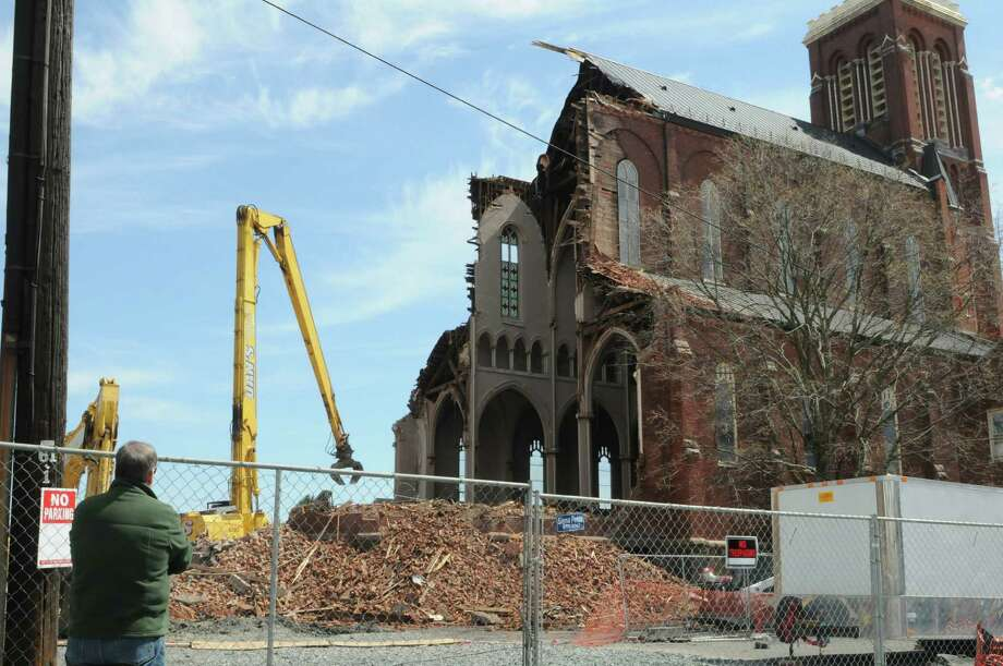 Demolition continues at St. Patrick's Church Monday afternoon, April 22, 2013, in Watervliet, N.Y.  (Will Waldron/Times Union) Photo: Will Waldron