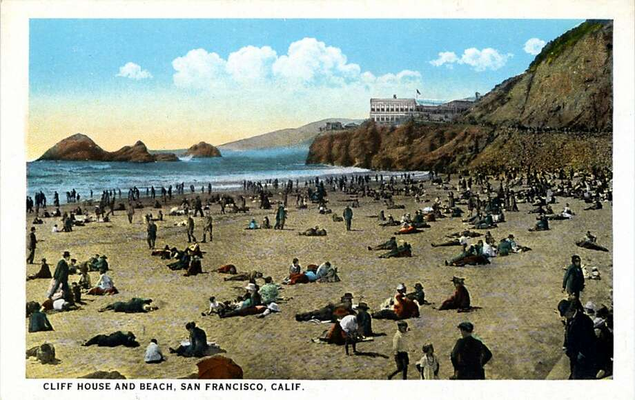 Vintage 1921 postcard showing beach with hundreds of sunbathers and the Cliff House on the rocks in the distance. Looks like swimwear hadn't been invented yet.  Photo: Curt Teich Postcard Archives