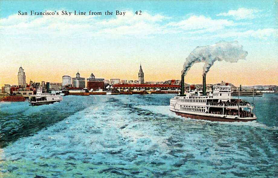 Vintage 1922 postcard showing the skyline of San Francisco from out in the bay. Two ferry boats steam toward the Ferry Building and docks in the distance. Photo: Curt Teich Postcard Archives