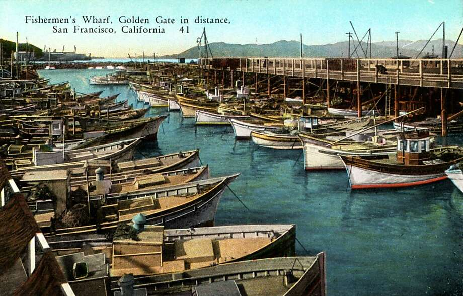 Vintage 1922 postcard showing fishing boats docked at Fisherman's Wharf.  Mountains and the unbridged Golden Gate are in the distance. Photo: Curt Teich Postcard Archives