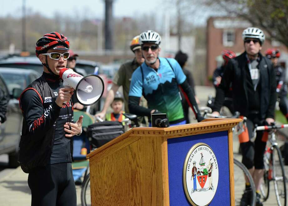 Danny Goodwin of NYCross.com uses a bull horn to speak to bikers as they line up for an Earth Day bike parade April 22, 2013 in Albany, N.Y.    (Skip Dickstein/Times Union) Photo: SKIP DICKSTEIN / 10022016A