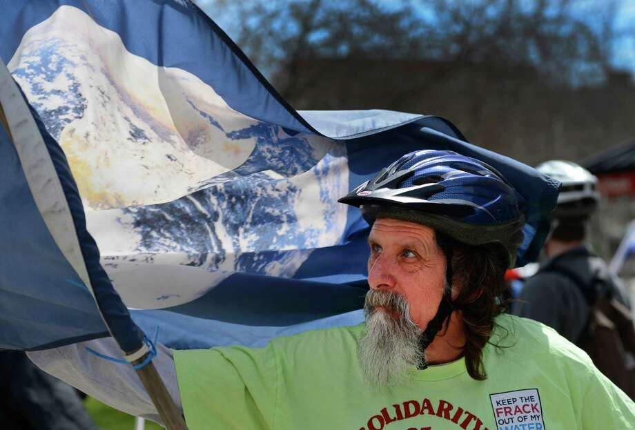 Fred Pfeiffer shows off his Earth Day flag during an earth day bike gathering April 22, 2013 in Albany, N.Y.    (Skip Dickstein/Times Union) Photo: SKIP DICKSTEIN / 10022016A