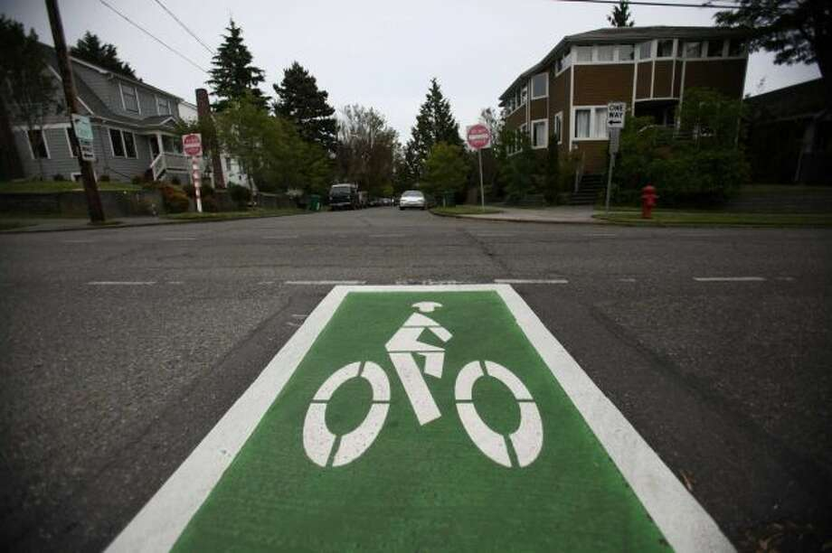 Know you're supposed to share the road with bicyclists, especially when you see green paint (''bike boxes'') and white arrows (''bike sharrows'').   (Also, if you've ever used ''sharrow'' as a real word). Photo: Joshua Trujillo, Seattlepi.com
