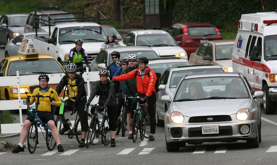 But still find bicyclists annoying, even when you know they're good for the environment, they're more vulnerable on the road than you, etc., etc., and it would suck to hit one. Photo: Mike Urban, Seattle Post-Intelligencer