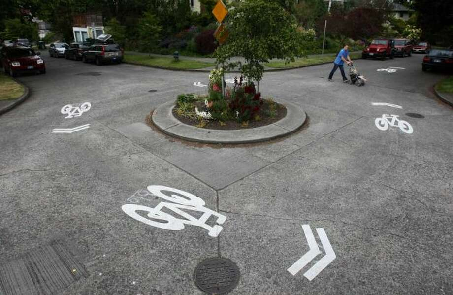 Know you're supposed to go around the traffic circle counter-clockwise, but cheat when you're late. And get mad when other people do the same. Photo: Joshua Trujillo , Seattlepi.com
