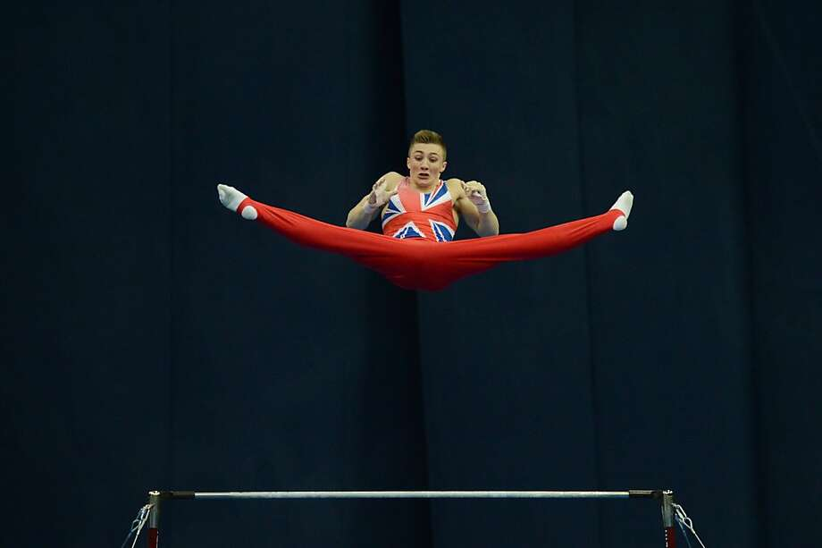 Second-place Sam: Britain's Sam Oldham launches himself off the horizontal bar during the European Artistic Gymnastic Individual Championships in Moscow. His routine was good enough for a silver medal. Photo: Natalia Kolesnikova, AFP/Getty Images