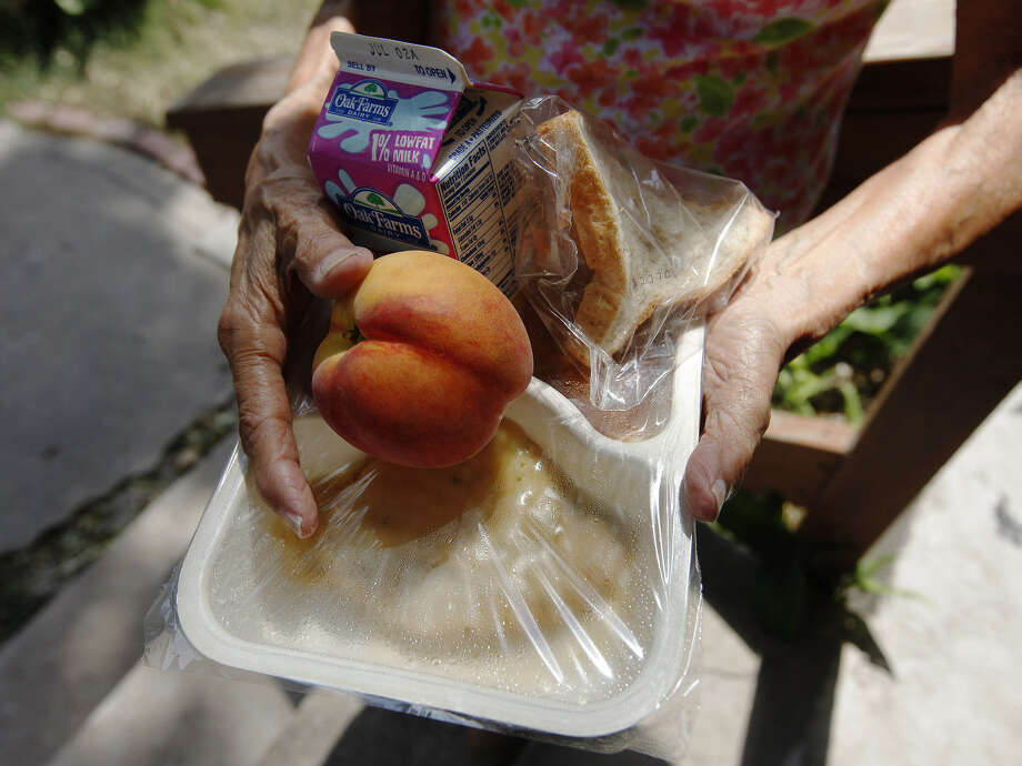 Meals on Wheels, a program that delivers hot nutritious meals for qualifying seniors over the age of 60, might have to scale back due to federal budget cuts. Photo: San Antonio Express-News File Photo