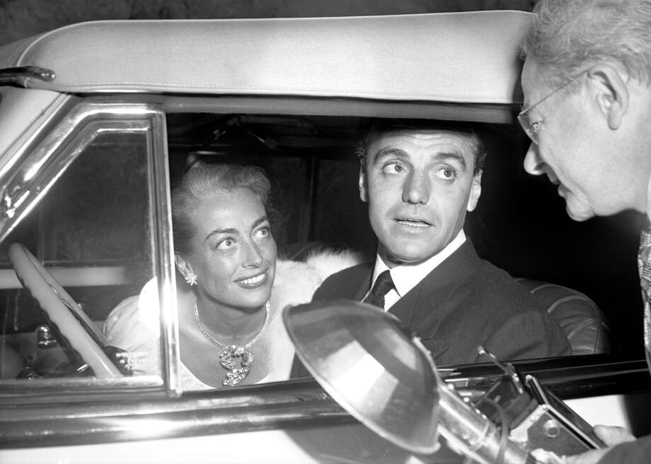 "The story of Hollywood playboy lawyer Greg Bautzer (seen here with Joan Crawford) is told in a new book ""The Man Who Seduced Hollywood"" by James Gladstone, who will be talking about it at two local events. Photo: Contributed Photo"