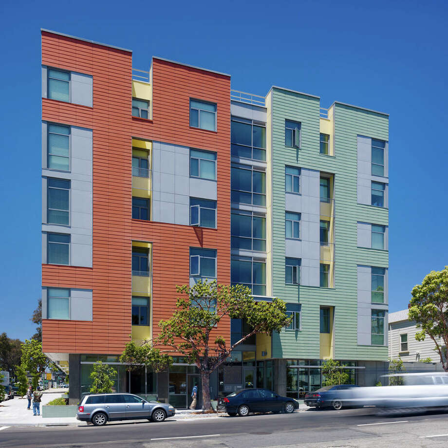 """Satellite Affordable Housing Associates' Merritt Crossing Senior Apartments are at the edge of Oakland's Chinatown, on what was an abandoned site near a busy freeway. It is one of the first new developments planned near the Lake Merritt BART regional transit station.""""The upper floor apartments respond to the character of the eclectic Pan-Asian neighborhood with colorful and varied porous facades that reflect their orientation,"""" a project writeup says. """"The south façade features an independent screen that provides shading, privacy and acoustical modulation while enlivening the view of passing freeway drivers.""""The ground floor features support services and community space, including a sunny garden courtyard. The 70 apartments are reserved for seniors with incomes between 30 percent and 50 percent of area median, with more than half for seniors who are homeless or at risk of homelessness, living with HIV/AIDS or challenged by mental illness. Photo: Tim Griffith"""