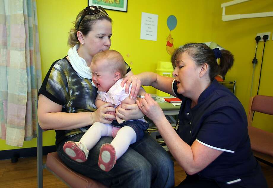 To be totally honest, this will hurt a bit: Fourteen-month-old Amelia Down bawls as she's vaccinated for measles, mumps and rubella at a drop-in clinic near Swansea, south Wales. Public health official were investigating the first suspected death from measles in Great Britain in five years following an outbreak blamed on a campaign against vaccinations. More than 800 people have contracted the highly contagious disease in Wales in the past six months. Photo: Geoff Caddick, AFP/Getty Images