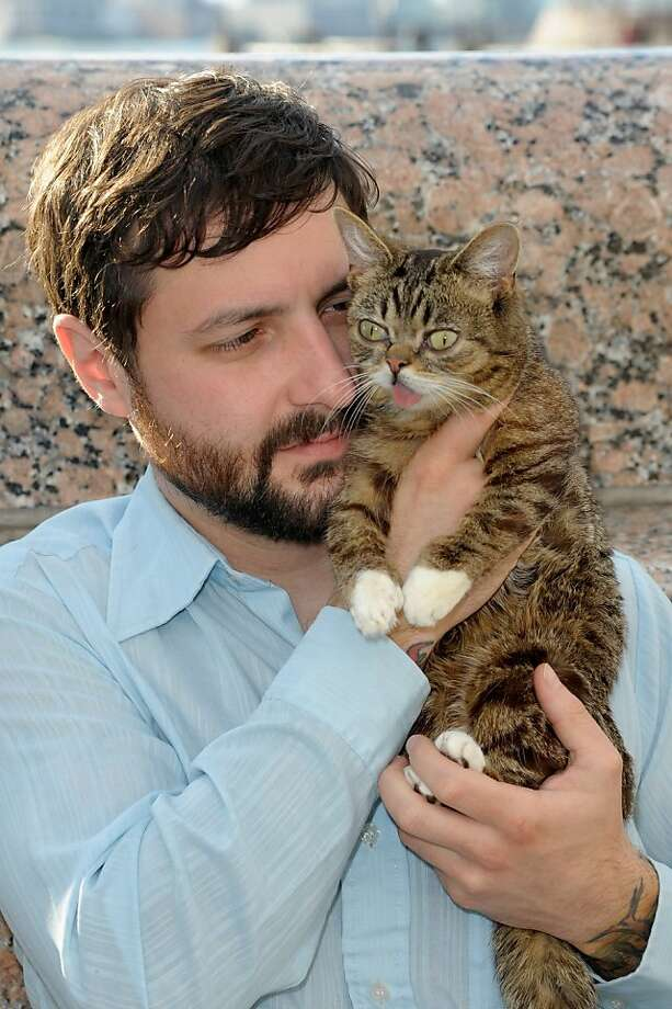 "The tabby with the strangely adorable face: Internet celebrity cat Lil Bub, who always looks like 1) she's out of breath or 2) she smells something weird attends the ""Lil Bub And Friendz"" screening with owner Mike Bridavsky at the Tribeca Film Festival in New York. Photo: Dave Kotinsky, Getty Images"