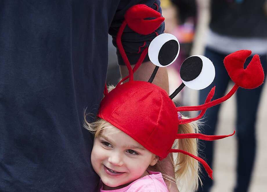 Who's your crawdaddy? Five-year-old Jayden Hall hugs an adult (presumably a relative) at the Texas Crawfish and Music Festival in Old Town Spring. Photo: J. Patric Schneider, For The Houston Chronicle