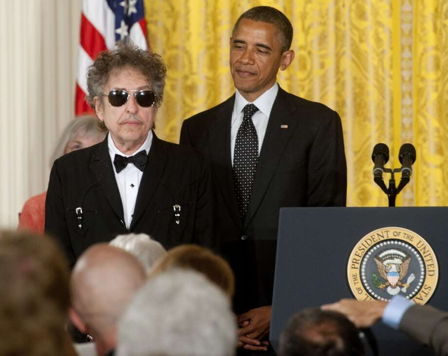 AmericanaramA featuring Bob Dylan, Wilco and My Morning Jacket rolls into Webster Bank Arena in Bridgeport July 19. Pictured here is Dylan receiving the Presidential Medal of Freedom from President Barack Obama in the East Room of the White House on May 29, 2012.
