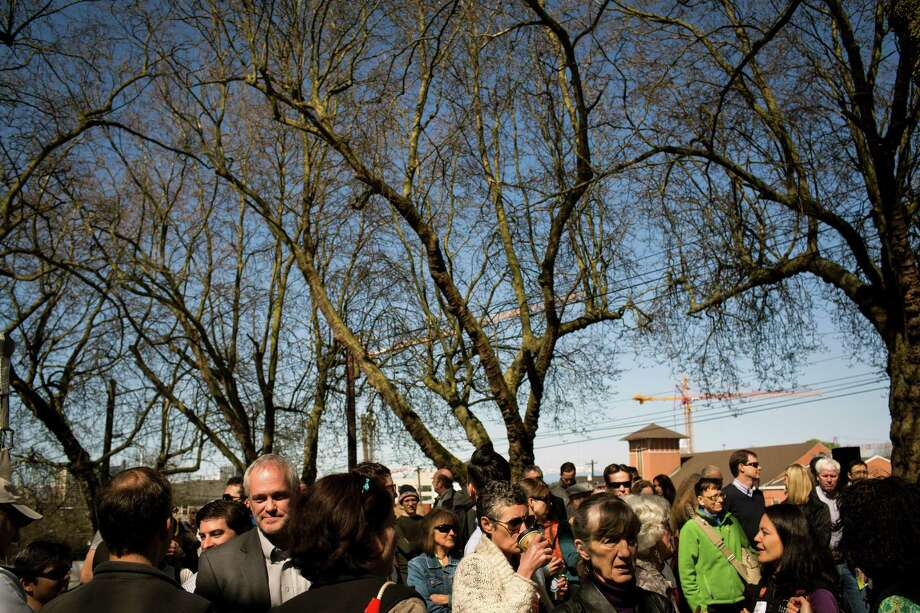 Crowds flocked to the grand opening of the Bullitt Center on Earth Day Monday, April 22, 2013, on Capitol Hill in Seattle. This six-story, 50,000 square-foot structure is the greenest commercial building in the world and aims to improve long-term environmental performance and efficiency through cutting-edge sustainable technology. Photo: JORDAN STEAD, SEATTLEPI.COM / SEATTLEPI.COM