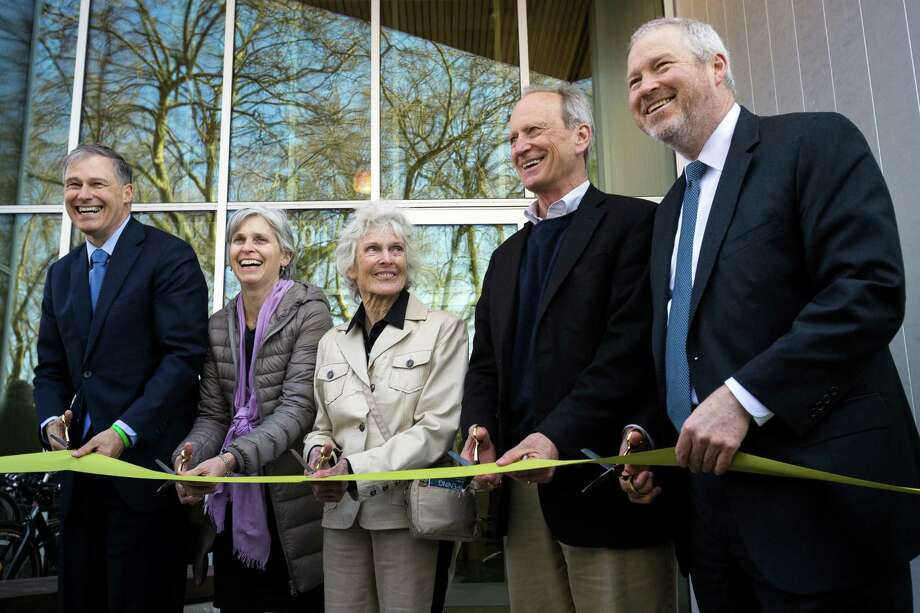 From left, Jay Inslee, Maud Daudon, Harriet Bullitt, Bullitt Foundation CEO Denis Hayes and Mike McGinn prepare to cut the ribbon at the grand opening of the Bullitt Center on Earth Day Monday on Capitol Hill in Seattle. This six-story, 50,000 square-foot structure is the greenest commercial building in the world and aims to improve long-term environmental performance and efficiency through cutting-edge sustainable technology. Photo: JORDAN STEAD, SEATTLEPI.COM / SEATTLEPI.COM
