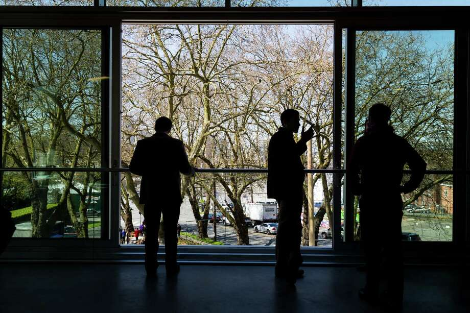 Event attendees meander through the halls, stairways and rooms of the newly-opened Bullitt Center on Earth Day Monday, on Capitol Hill in Seattle. This six-story, 50,000 square-foot structure is the greenest commercial building in the world and aims to improve long-term environmental performance and efficiency through cutting-edge sustainable technology. Photo: JORDAN STEAD, SEATTLEPI.COM / SEATTLEPI.COM