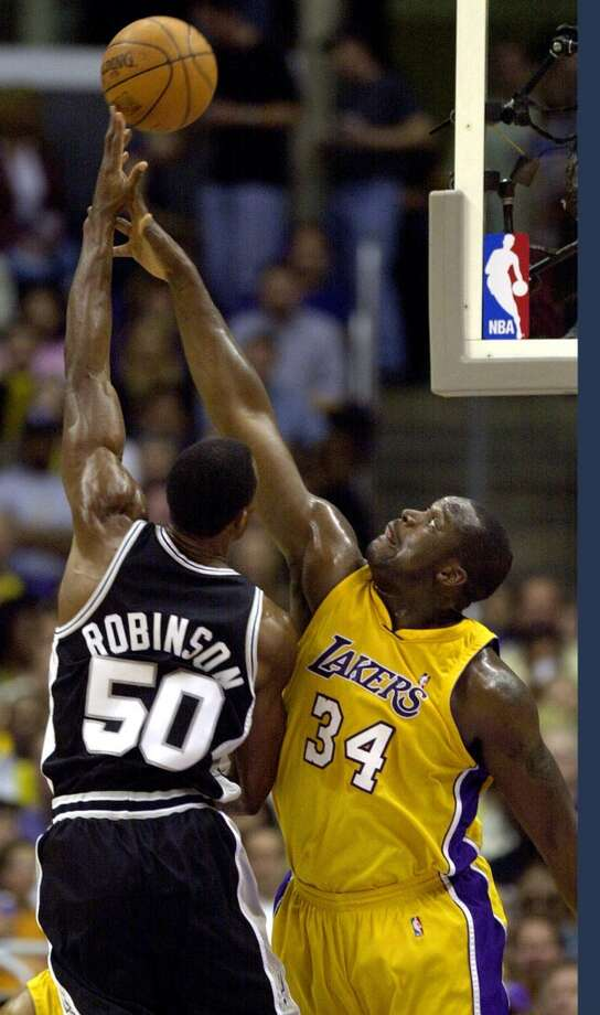 The Spurs and Lakers have squared off in the playoffs 12 times since their first postseason meeting in 1983.  The Spurs\' David Robinson shoots over the Lakers\' Shaquille O\'Neal on May 25, 2001.