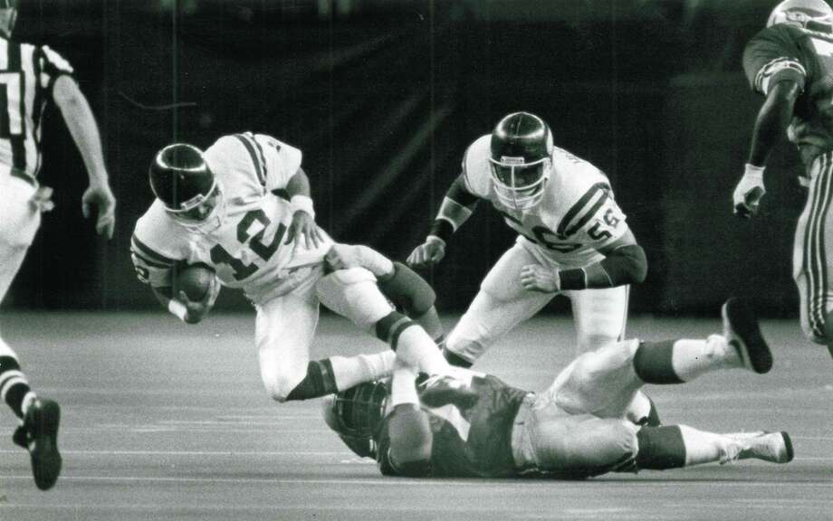 1979: Manu Tuiasosopo18th-overall pick | Position: Defensive tackle | College: UCLA  Pictured here on the ground, Tuiasosopo played five years for the Seahawks before joining the San Francisco 49ers in 1984, when they won the Super Bowl. He's the father of former Mariners minor-leaguer Matt Tuiasosopo, former UW and NFL quarterback Marques Tuiasosopo, former UW fullback Zach Tuiasosopo, UW assistant women's soccer coach Leslie Tuiasosopo and former UW softball player Ashley Tuiasosopo. Photo: Gary W. Tolman, Seattle P-I File