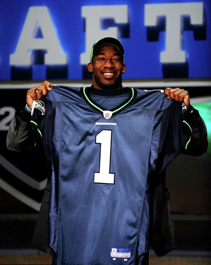 2009: Aaron Curry4th-overall pick | Position: Linebacker | College: Wake Forest  One of the most hyped players in the 2009 draft, Curry was snatched up by the Seahawks on a six-year, $60 million rookie contract. He immediately became a starter, but tallied 60 total tackles his rookie season and 70 tackles in 2010. Five games through the 2011 season, having made 68 tackles, Seattle Curry him to the Oakland Raiders for a seventh-round pick in the 2012 draft and a conditional pick in 2013. As a Raider in 2012, he appeared in just two games and recorded no stats. He announced his retirement from the NFL on Aug. 28, 2013. Some consider Curry one of Seattle's biggest draft busts. Photo: Jeff Zelevansky, Getty Images / 2009 Getty Images