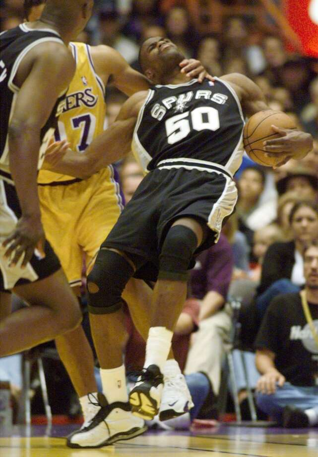 The Spurs-Lakers rivalry wasn\'t always friendly. The Lakers\' Rick Fox was called for a flagrant foul when he clotheslined the Spurs\' David Robinson in Game 3 on Saturday, May 22, 1999.