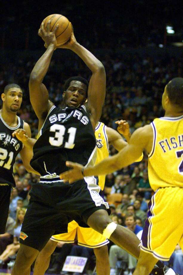 The Spurs\' Malik Rose grabs a rebound during Game 3 on May 22, 1999. Rose became a fan favorite with his energetic play off the bench.
