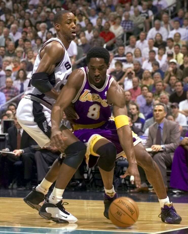 The Spurs\' Sean Elliott plays defense on the Lakers\' Kobe Bryant in Western Conference semifinals Game 2 on May 19, 1999. In addition to helping the Spurs win their first title, Elliott made NBA history later in his career when he returned from a kidney transplant.