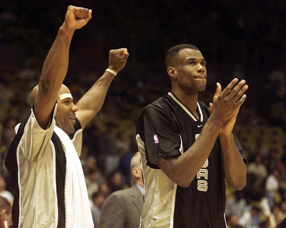 The Spurs\' Mario Elie (left) and David Robinson celebrate as the fourth quarter of the Western Conference semifinal  against the Lakers ends 23 May, 1999. The Spurs defeated the Lakers to advance to the Western Conference Finals.
