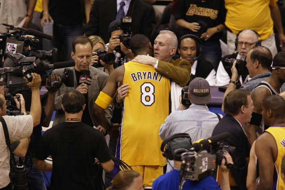 The Lakers\' Kobe Bryant  congratulates Spurs coach Gregg Popovich after the Spurs won Game 6 of the Western Conference semifinals during the 2003 NBA Playoffs at Staples Center on May 15, 2003 in Los Angeles.  The Spurs won 110-82.