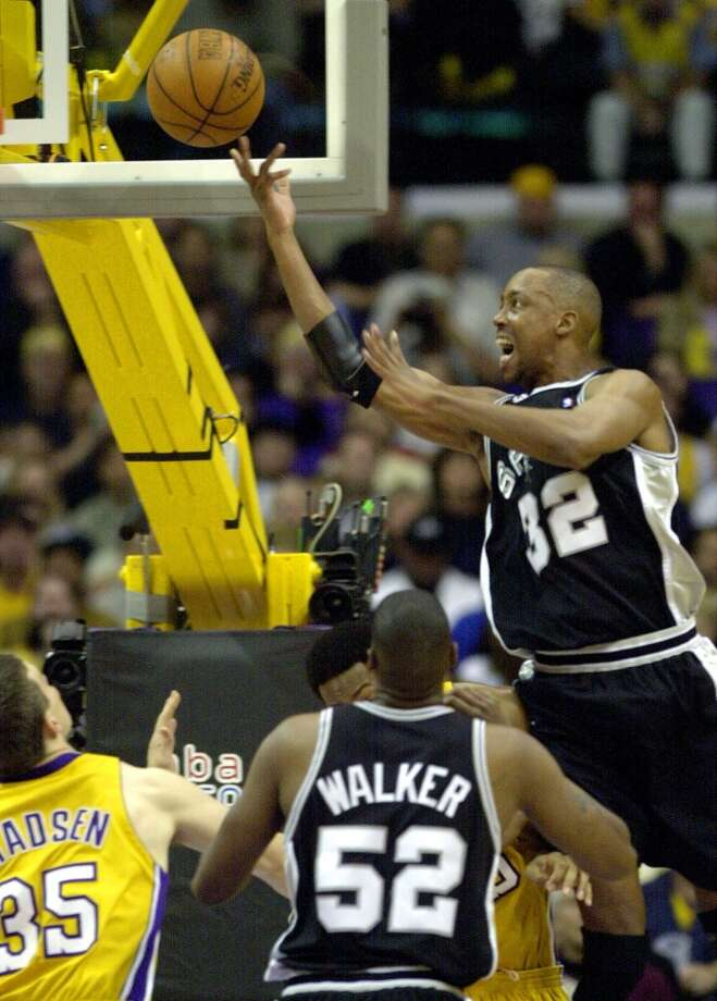 Sean Elliott puts up a shoot as Lakers Mark Madsen(35) ans Spurs Samaki Walker look on at the Staples Center in Los Angeles Sunday May 27, 2001.