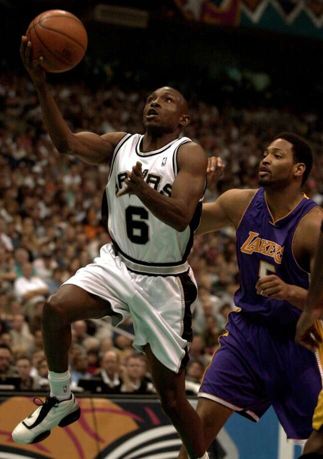 The Spurs\' Avery Johnson (6) drives to the basket around the Lakers\' Robert Horry (5) during first half action at the Alamodome on Saturday, May 19, 2001. Horry later joined the Spurs.